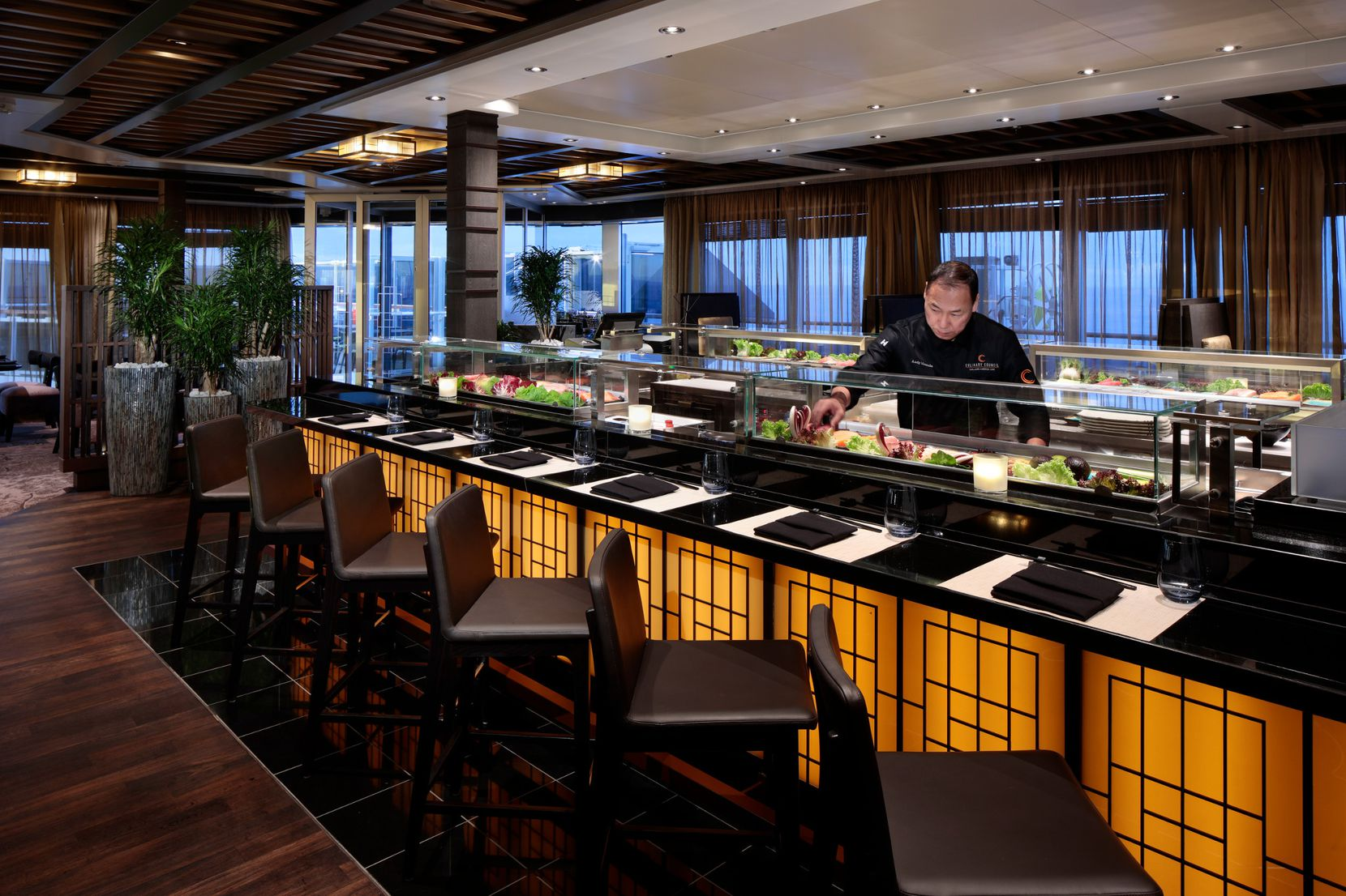 A member of the crew works at Nami Sushi aboard the Nieuw Statendam.
