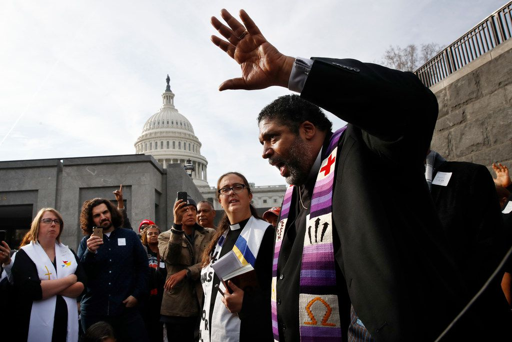 """The Rev. William Barber II, with the """"Poor People's Campaign,"""" speaks to the group after they prayed inside of the Capitol Rotunda in protest of the GOP tax overhaul, Monday, Dec. 4, 2017, on Capitol Hill in Washington."""
