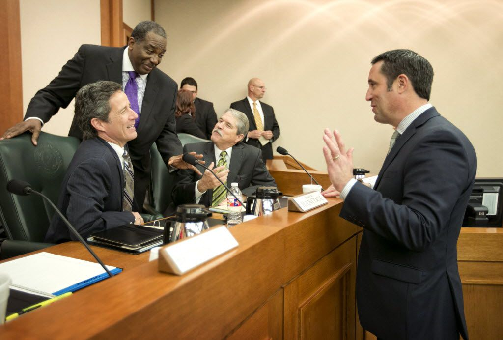 State comptroller Glenn Hegar, right, chatted with former colleagues in the Texas Senate a year ago before testifying about the effects of declining oil prices on the state budget. (Jay Janner/Austin American-Statesman)