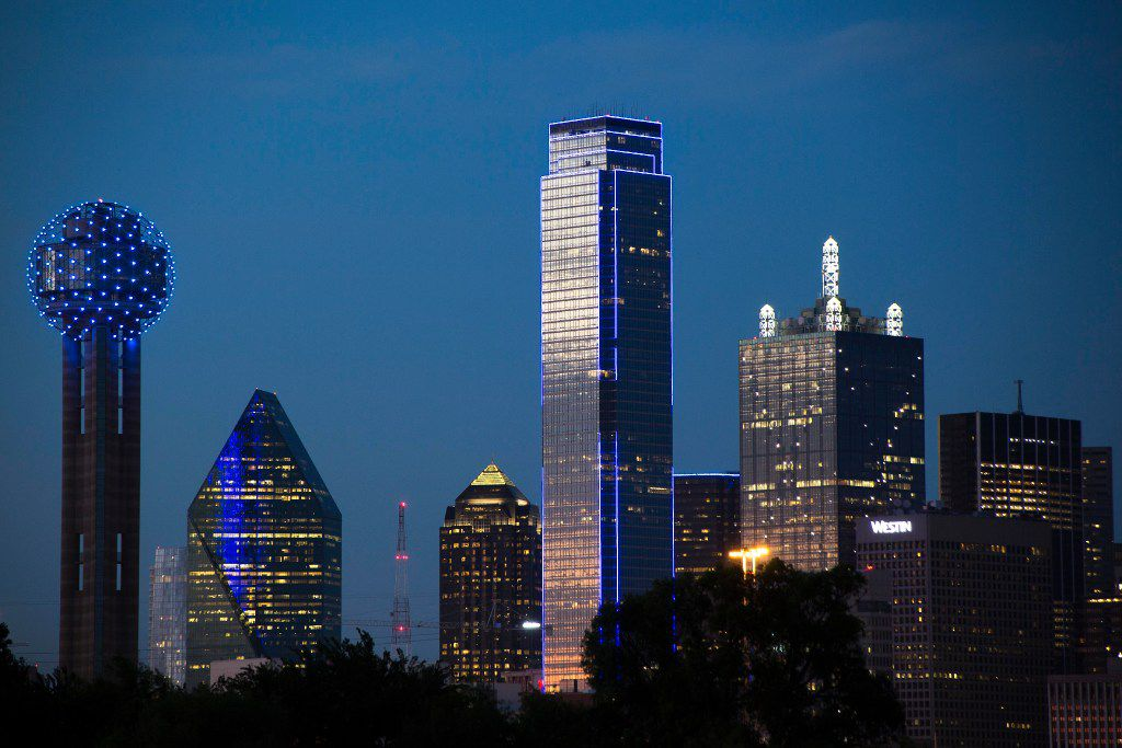 The downtown Dallas skyline lights up in blue in recognition of National Police Week on Monday, May 15, 2017. (Smiley N. Pool/The Dallas Morning News)