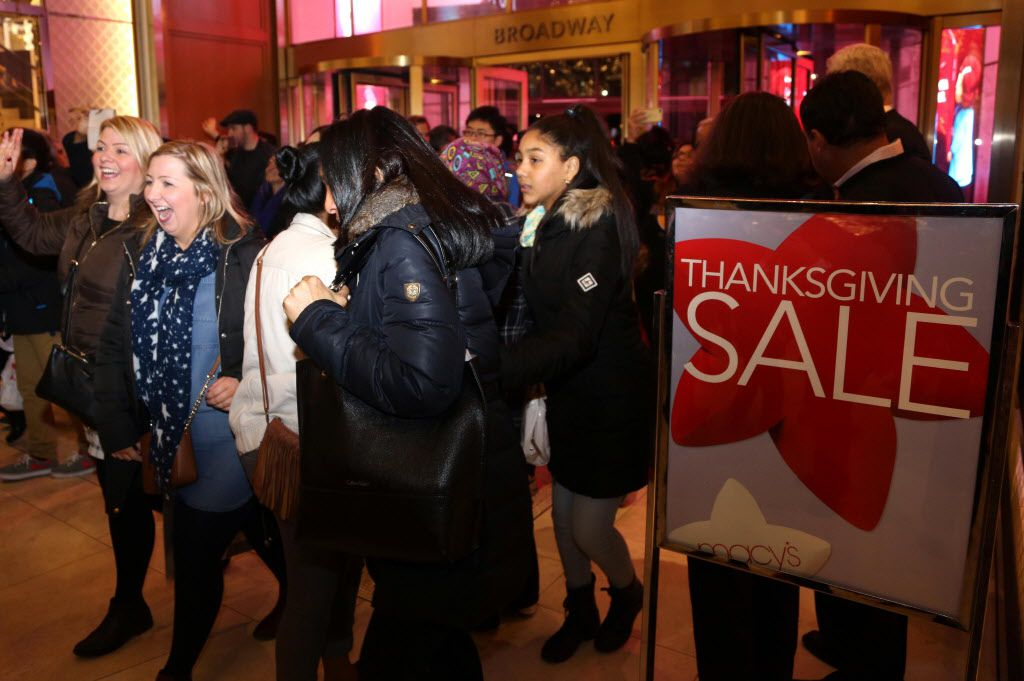 The first shoppers enter Macys department store in Herald Square, New York, on November 26, 2015.