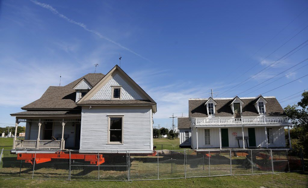 Two of Garland's oldest houses were on flatbeds downtown while their futures were decided. The Pace House was moved to the Travis College Hill District and the Lyles House (right) to the city's new Heritage Park.