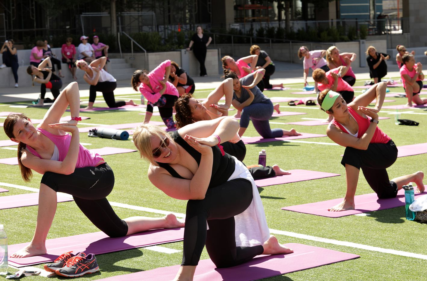 Susan G. Komen supporters participate in project:OM, a cancer research yoga event, held at The Star in Frisco on May 13, 2017.