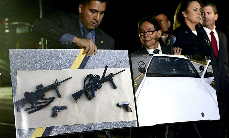 Photos of weapons used in the San Bernardino massacre are displayed at a news conference held Thursday by Calif. Gov. Jerry Brown. (Axel Koester/The New York Times)