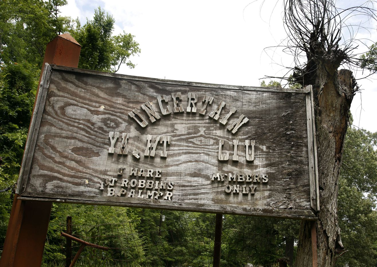 The sign at the entrance to the private Uncertain Yacht Club has seen better days. Photographed at Caddo Lake in Uncertain, Texas Tuesday June 19, 2018.