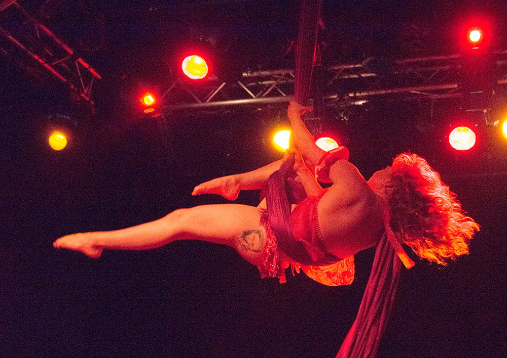 Bethany Summersizzle, who plays Clara in the ballet, swings from scarves at Trees in Deep Ellum.