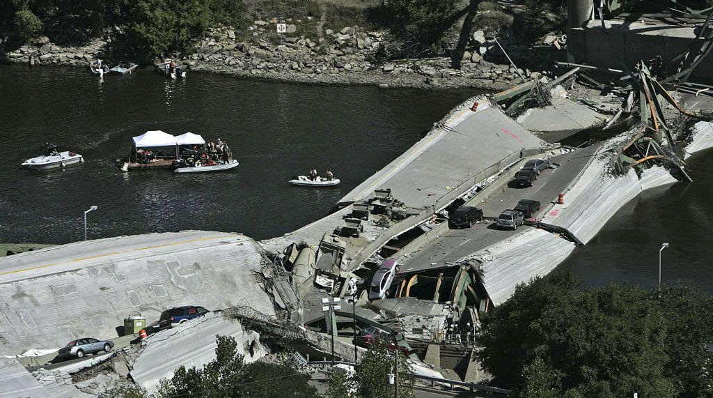 FILE photo shows divers during recovery efforts following the 35W bridge collapsed in Minneapolis in 2007.  (AP Photo/Minneapolis Star Tribune, Jim Gehrz)