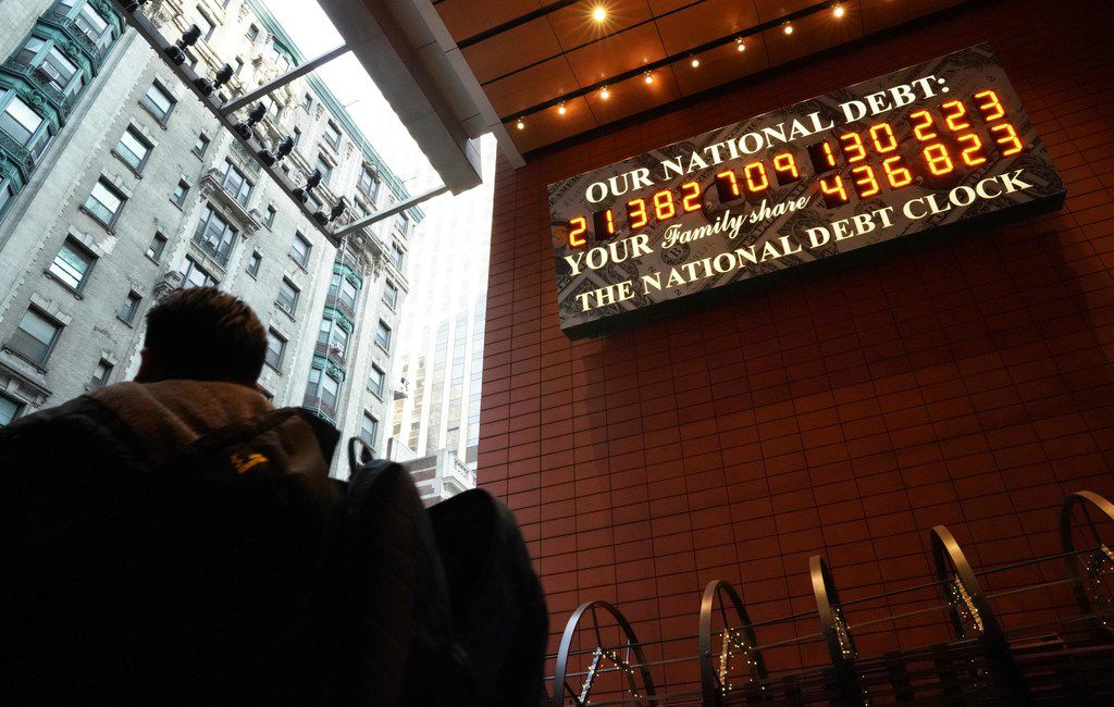 A man walks past the he National Debt Clock on 43rd Street in midtown New York City on Feb. 15.