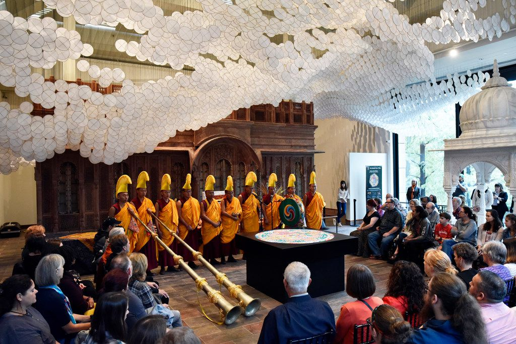 Buddhist monks conduct a special ceremony to dismantle a mandala, a piece of art work made of colorful sand, during the Mystical Arts of Tibet closing ceremonies at the Crow Museum of Asian Art in downtown Dallas, Saturday, Oct. 13, 2018.