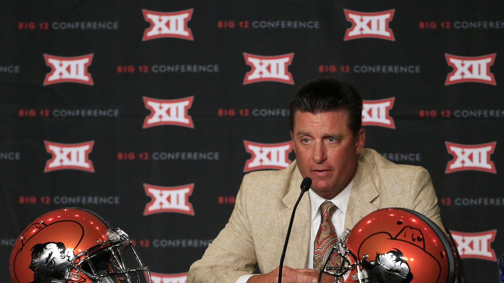 Jul 21, 2015; Dallas, TX, USA; Oklahoma State Cowboys head coach Mike Gundy speaks to the media during the Big 12 Media Days at Omni Dallas. Mandatory Credit: Kevin Jairaj-USA TODAY Sports