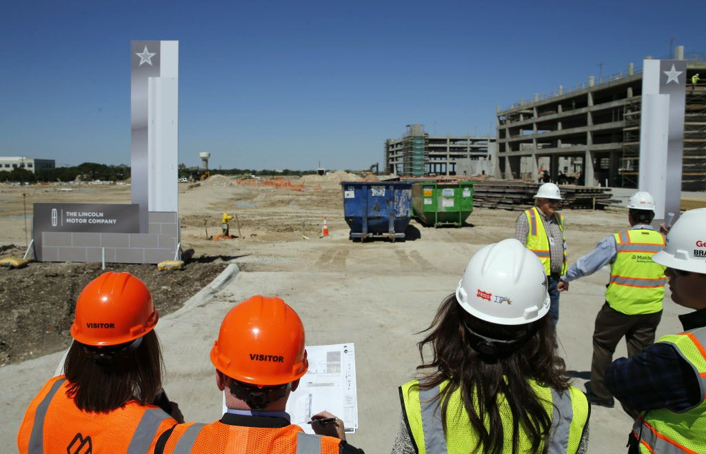 Charlotte Jones Anderson (center) Executive Vice President and Chief Brand Officer for the Dallas Cowboys surveys the look of the signs during a tour of exterior signs with a team of directors and designers at the Dallas Cowboys new headquarters at The Star in Frisco, on Tuesday, May 3, 2016. The Star a joint project with the City of Frisco is scheduled to open in August. (Vernon Bryant/The Dallas Morning News)