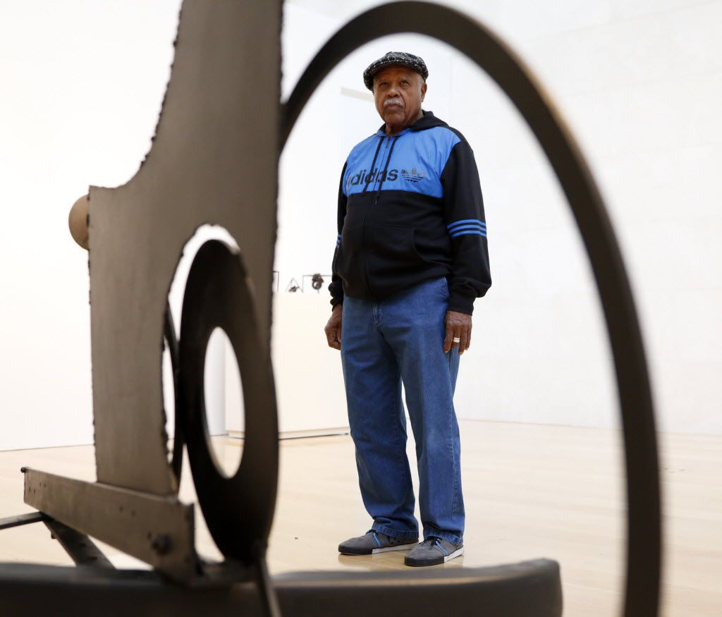 Melvin Edwards poses for a photograph near one of his sculptures, 'The Fourth Circle, 1966,' at the Nasher Sculpture Center in 2015. An exhibition at the time of Edwards' welded steel sculptures encompassed his work over the previous five decades.