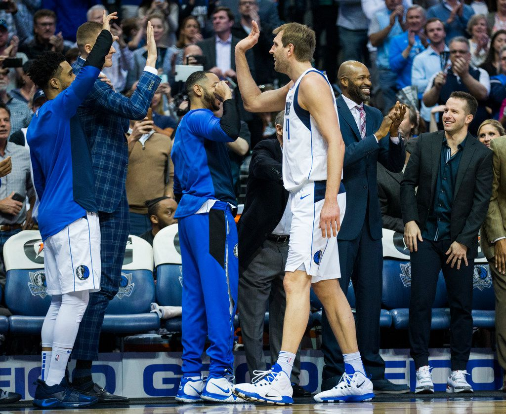 Dallas Mavericks forward Dirk Nowitzki (41) gets high-fives at the bench after passing Wilt Chamberlain for the 6th NBA all-time scoring record during the first quarter of an NBA game between the Dallas Mavericks and the New Orleans Pelicans on Monday, March 18, 2019 at American Airlines Center in Dallas. (Ashley Landis/The Dallas Morning News)