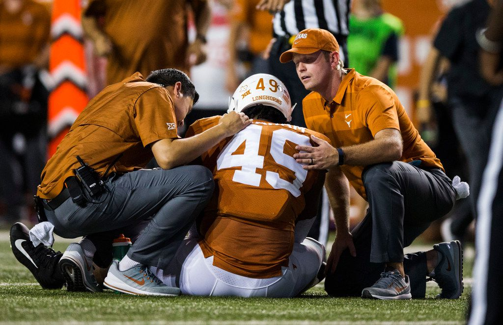 Texas Longhorn defensive lineman Ta'Quon Graham is checked out after an injury during the second quarter of an NCAA football game between the Texas Longhorns and the USC Trojans on Saturday, September 15, 2018 at Darrell K Royal Memorial Stadium in Austin, Texas. (Ashley Landis/The Dallas Morning News)