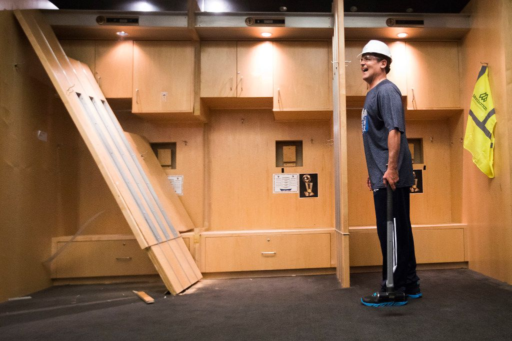 Dallas Mavericks owner Mark Cuban smiles after taking a sledgehammer to lockers to begin the demolition process of the Mavericks locker room during a press availability before the 2017 NBA Draft at American Airlines Center on Thursday,June 22, 2017, in Dallas. The team is renovating the locker room into a state-of-the-art facility for the start of next season. (Smiley N. Pool/The Dallas Morning News)