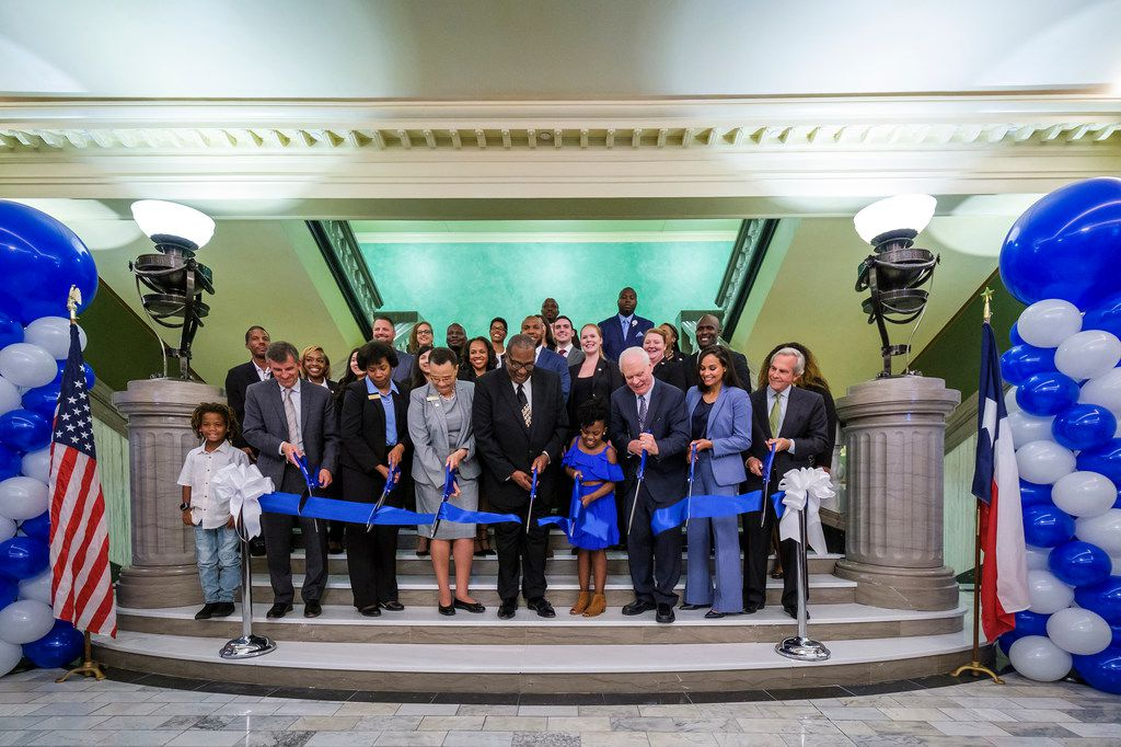 Dignitaries participated in a ribbon-cutting ceremony for the UNT Dallas College of Law's move into the new Dallas Law Center on June 6, 2019, in Dallas. With scissors (from left) are Steve Maruszewski, Vice Chancellor of the UNT System, Betty Stewart, Provost, UNT Dallas, Felecia Epps, Dean, UNT Dallas College of Law, state Sen. Royce West, Sky Turner, UNT Dallas President Bob Mong, UNT Dallas 2019 graduate Amanda Pajares and Lee Jackson, Chancellor Emeritus of the UNT System.