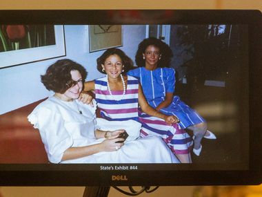 A photograph of Katherine Bascone (center) from the 1980s is displayed by prosecutors as testimony begins in the capital murder trial for George Guo.