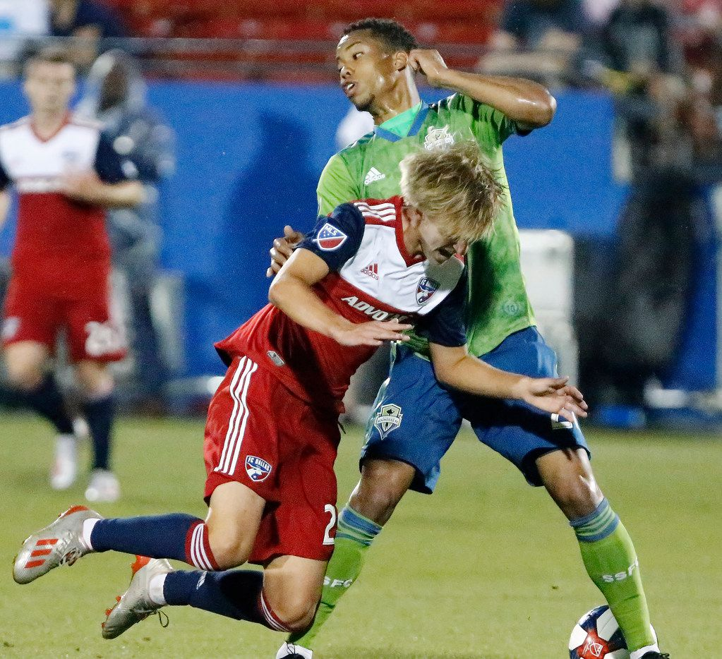 FC Dallas midfielder Thomas Roberts (23) is knocked off of his feet by Seattle Sounders midfielder Jordy Delem (21) during the first half as FC Dallas hosted the Seattle Sounders at Toyota Stadium in Frisco on Saturday, June 1, 2019.  (Stewart F. House/Special Contributor)
