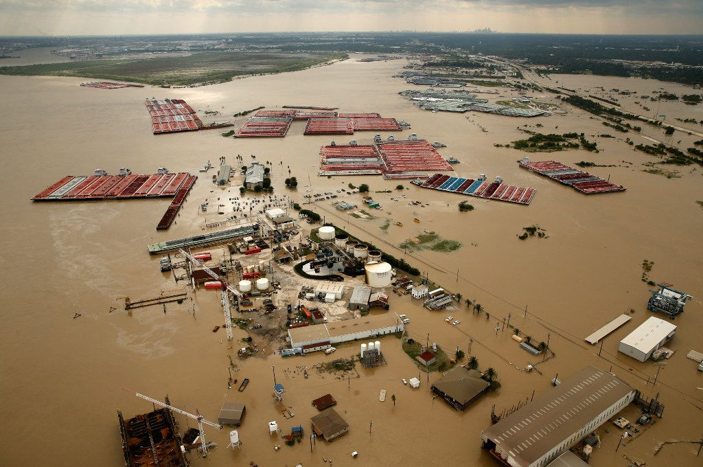 Barges are secured by tugboats in the flood swollen Burnet Bay along the Houston Ship Channel in Houston, Wednesday, August 30, 2017. The Buffalo Bayou empties into the bay nearby. Hurricane Harvey flooded the industrial areas and the rest of Houston.