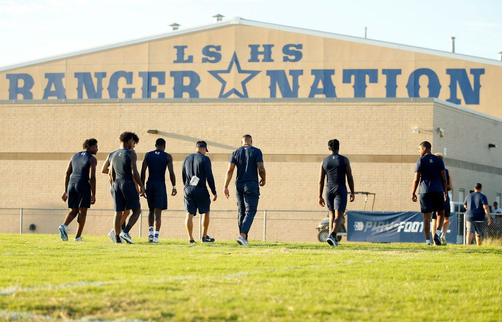 Dallas Cowboys quarterback Dak Prescott (third from right) joined Lone Star High School football players to film a Chunky Soup commercial at the schools practice field, Monday, September 17, 2018. (Tom Fox/The Dallas Morning News)
