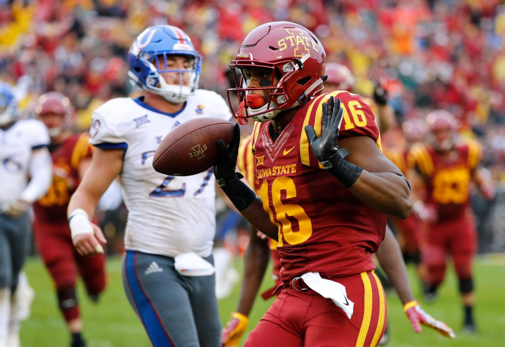 AMES, IA - OCTOBER 14: Wide receiver Marchie Murdock #16 of the Iowa State Cyclones runs into the end zone for a touchdown as cornerback DeAnte Ford #27 of the Kansas Jayhawks defends on the play in the second half of play at Jack Trice Stadium on October 14, 2017 in Ames, Iowa. The Iowa State Cyclones won 45-0 over the Kansas Jayhawks. (Photo by David Purdy/Getty Images)