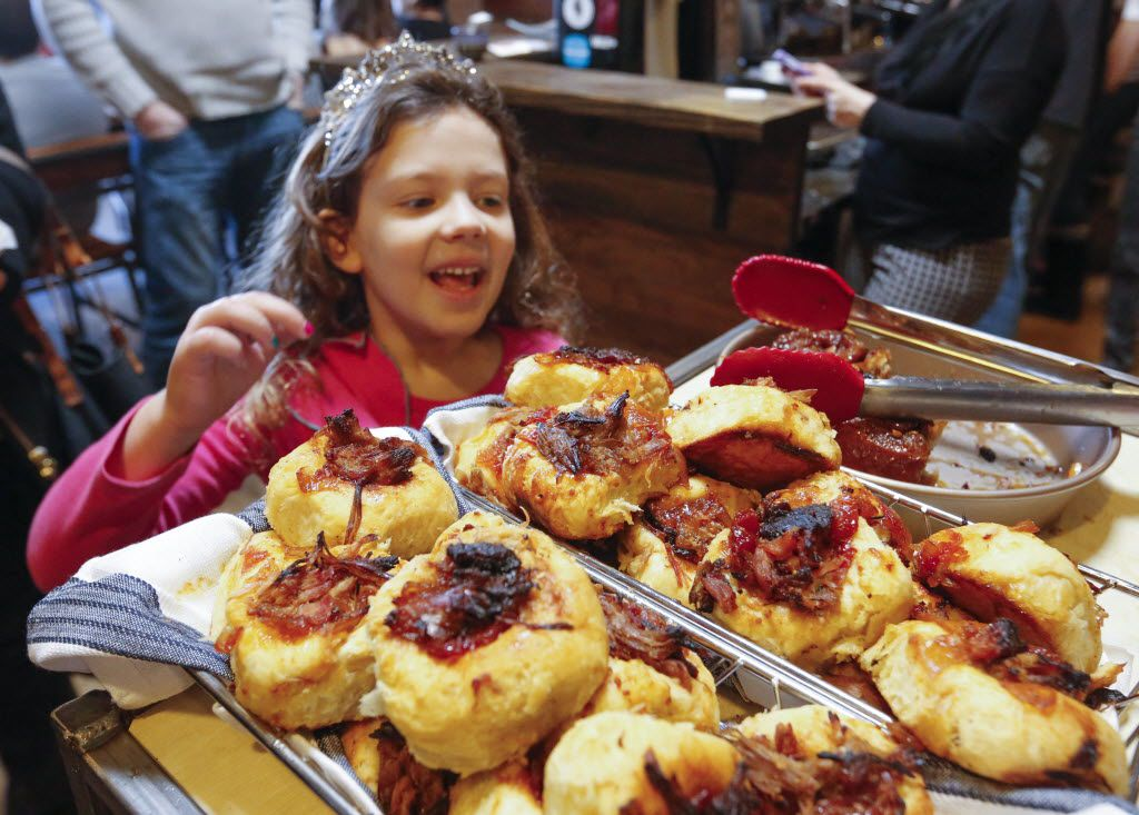 Ella McCallister, 6, picks out fresh pastry during a visit to Full City Rooster.
