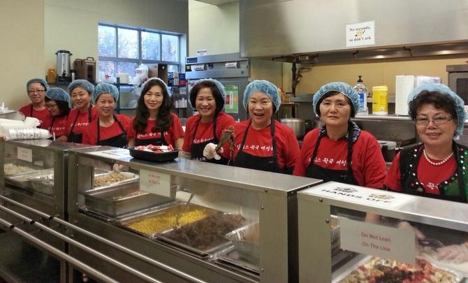 Members of the Korean American Women's Association of Dallas serve Korean food at Center of Hope in Dallas.