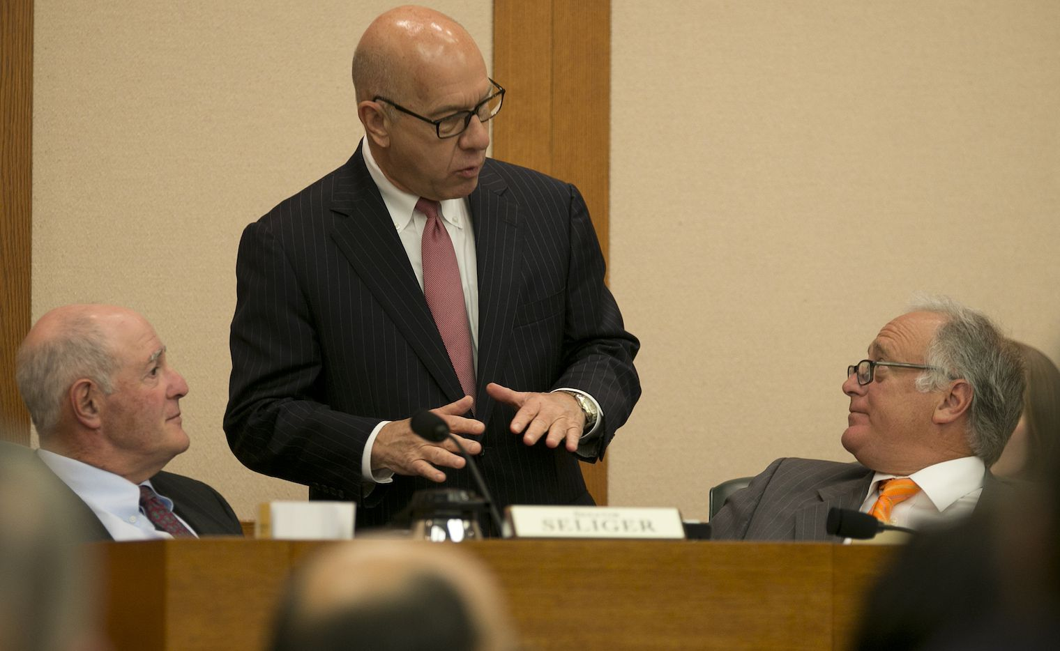 """Texas Sen. John Whitmire, center, speaks with Sen. Kel Seliger, left, and Sen. Kirk Watson during a Senate Finance Committee hearing Feb. 23 at the state Capitol in Austin. Whitmire has proposed a bill that would abolish the """"pick-a-pal"""" grand jury selection system. The bill was approved by the Senate's criminal justice committee Tuesday. (AP Photo/Austin American-Statesman, Deborah Cannon)"""