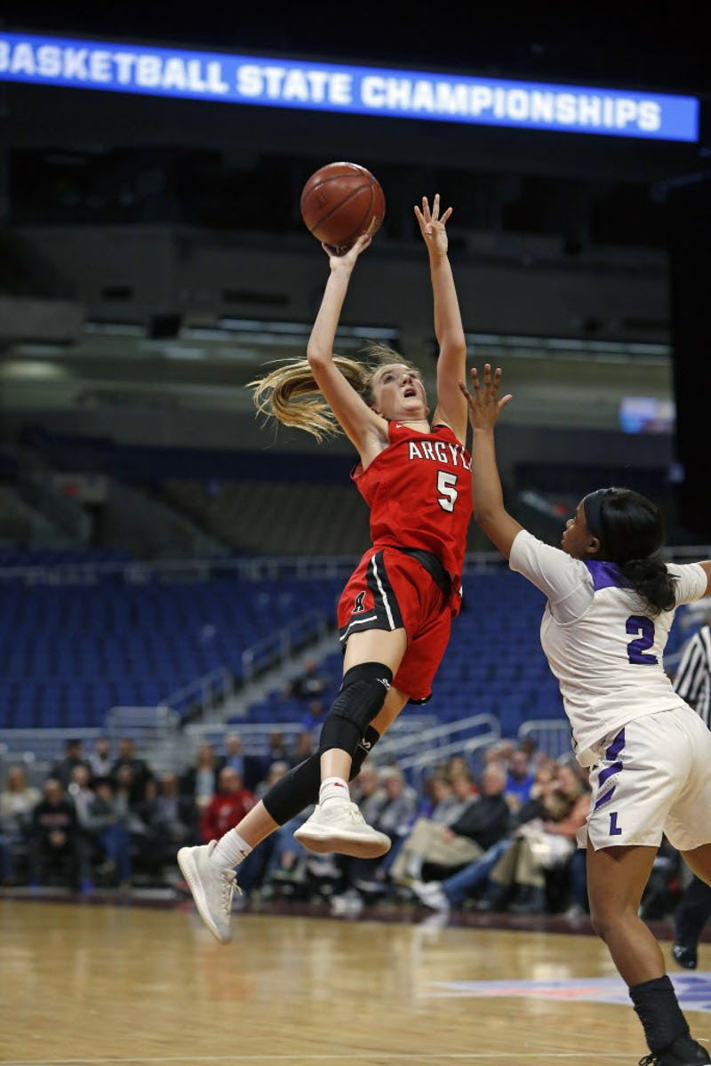Argyle's Rhyle McKinney shoots in closing seconds and was fouled by Dallas Lincoln's JaMya Maryland enabling Argyle to win the contest. Argyle v Dallas Lincoln in 4A semifinals on Friday, March 1, 2019 at the Alamodome in San Antonio, Texas. ORG XMIT: 10043969A