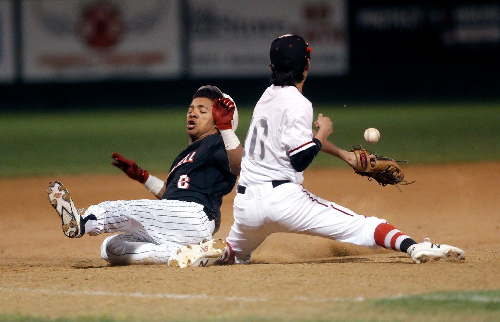 Coppell's De Heath (6) slides safely into third on an RBI triple as Lake Highlands third baseman Evan Garcia (1) reaches for the throw from the outfield during Coppell's 10-1 win on Thursday. (Brandon Wade/Special Contributor)