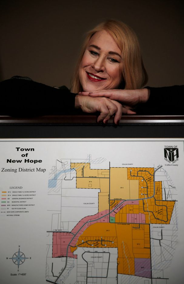 Mayor Jess Herbst displays a zoning district map at the Town Hall in New Hope.