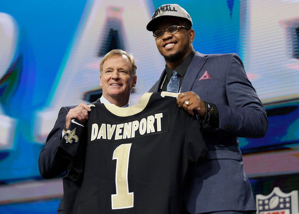 Commissioner Roger Goodell, left, presents UTEP's Marcus Davenport with his New Orleans Saints jersey during the first round of the NFL football draft, Thursday, April 26, 2018, in Arlington, Texas. (AP Photo/David J. Phillip)