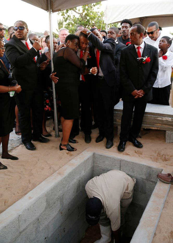 Allison and Bertrum Jean hug as they surrounded by family and friends as their son Botham Shem Jean is buried at Choc Cemetery in Castries, St. Lucia on Monday, September 24, 2018. Jean was shot and killed in his apartment by off duty Dallas police officer Amber Guyger. (Vernon Bryant/The Dallas Morning News)