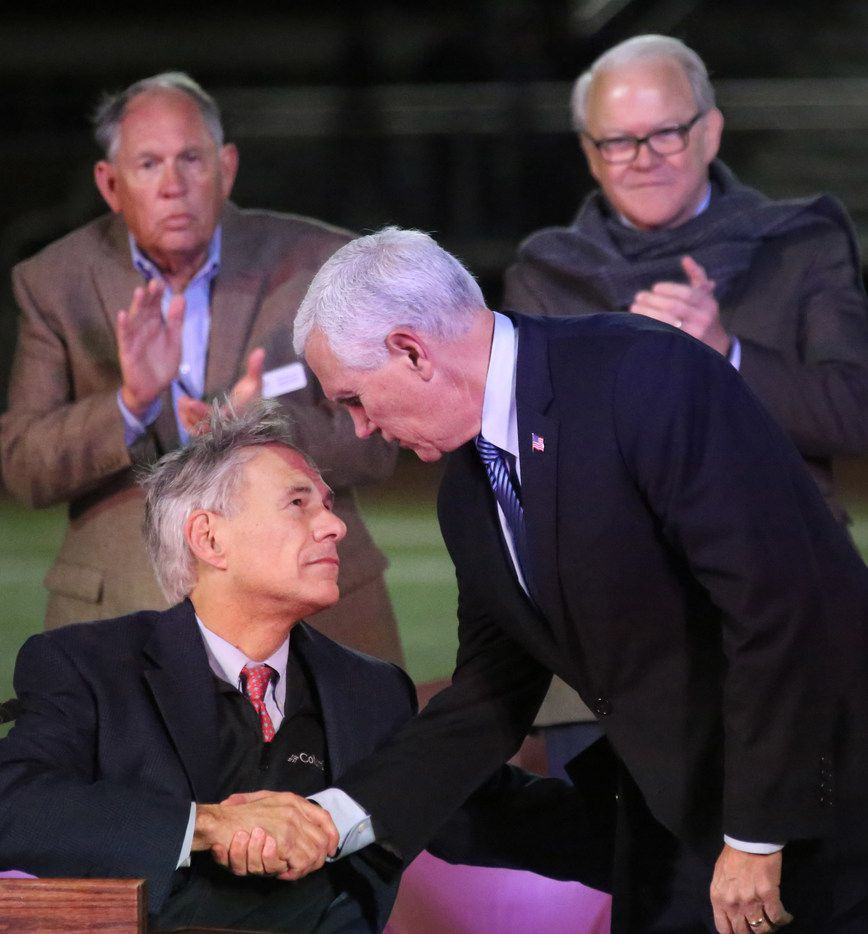 United States Vice President Mike Pence shakes hands with Texas Governor Greg Abbott at a memorial service for slain members of the First Baptist CHurch of Sutherland Springs, held at the Floresville High School football stadium on Wednesday.