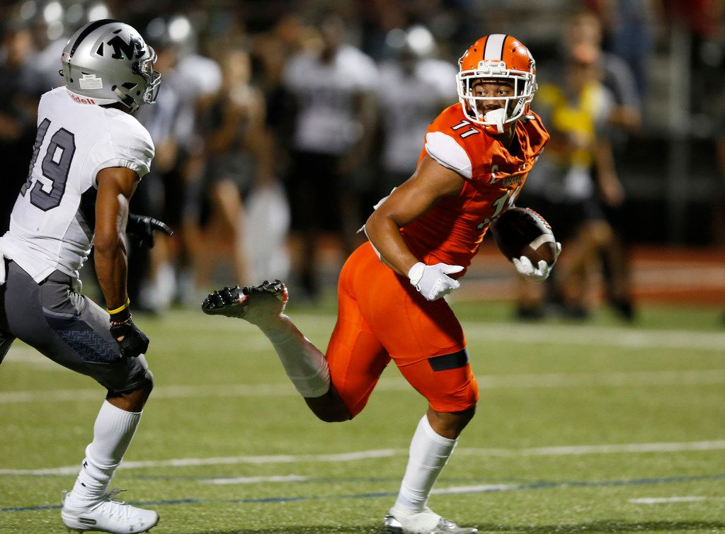 Rockwall's Jaxon Smith-Njigba (11) runs in for a touchdown as he is chased by Arlington Martin's Placide Djungu-Sungu (19) during the first half of play at Wilkerson-Sanders Memorial Stadium in Rockwall, Texas on Friday, September 20, 2019. (Vernon Bryant/The Dallas Morning News)