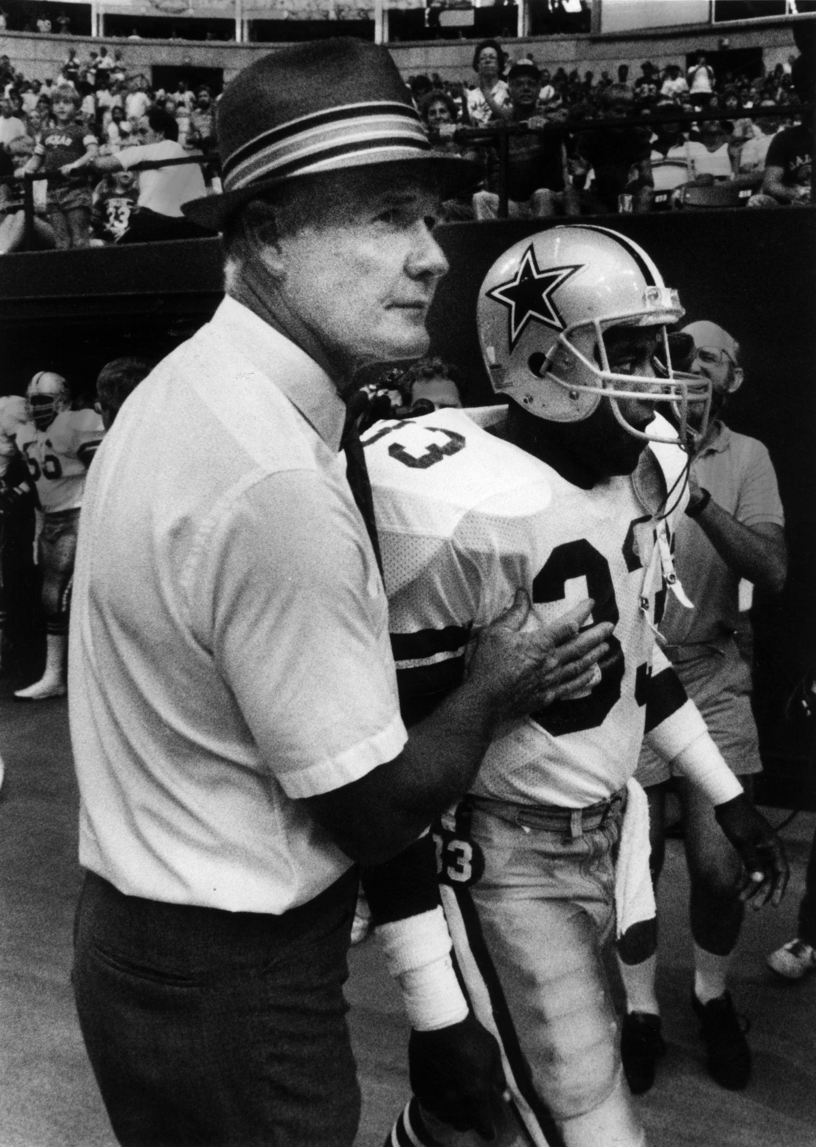 Cowboys coach Tom Landry with Tony Dorsett at player introduction at beginning of game.