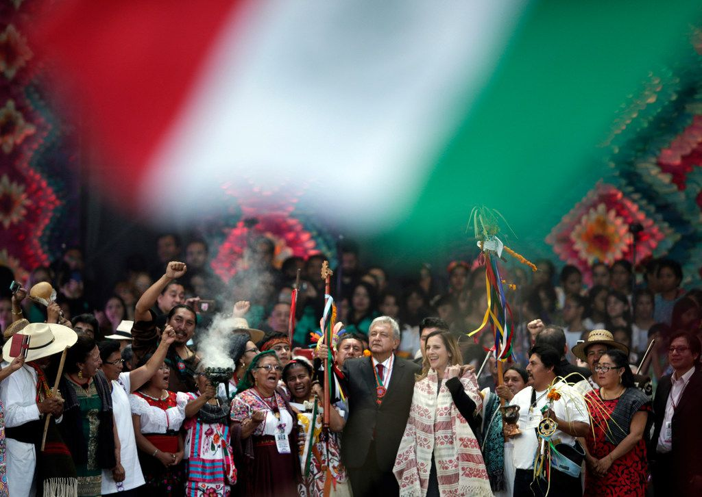 Lopez Obrador holds a chieftain's staff during a traditional indigenous ceremony at the Zocalo, in Mexico City, Saturday, Dec. 1, 2018.
