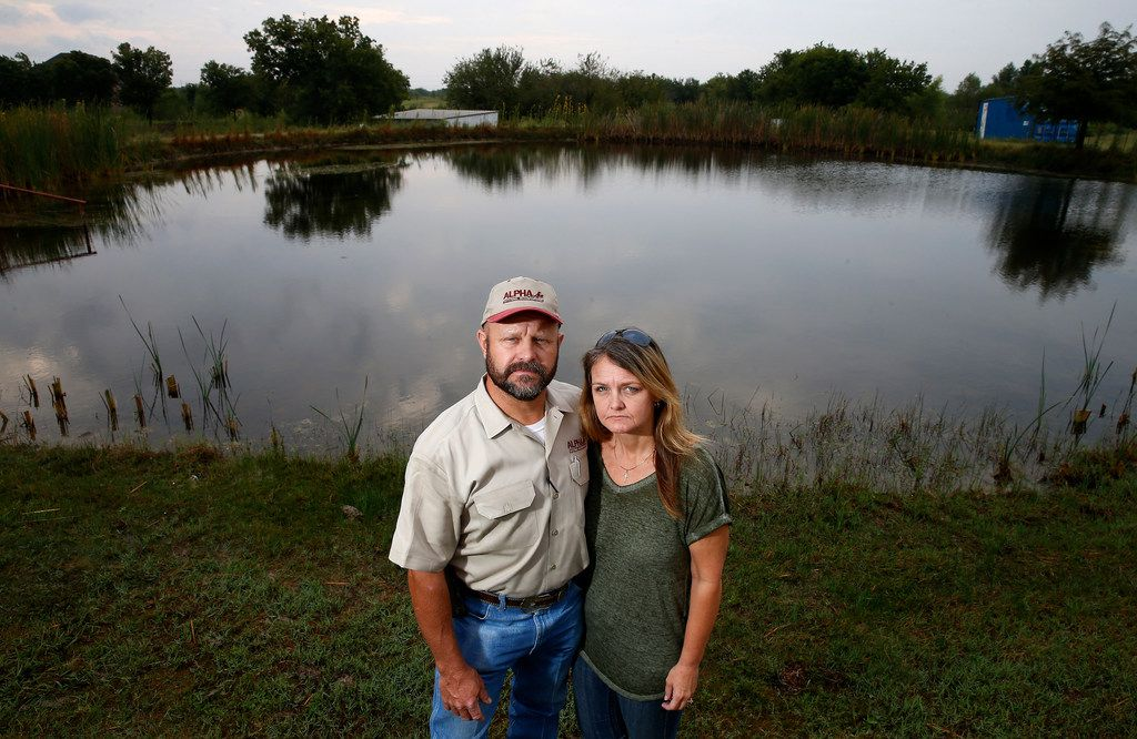 Kaufman County residents John and Kristina Bomer pose for a photograph near the pond on their property near Forney. The couple grew up in Mesquite and moved to the Forney area 17 years ago. They oppose a proposed annexation by the city of Mesquite. (Jae S. Lee/The Dallas Morning News)