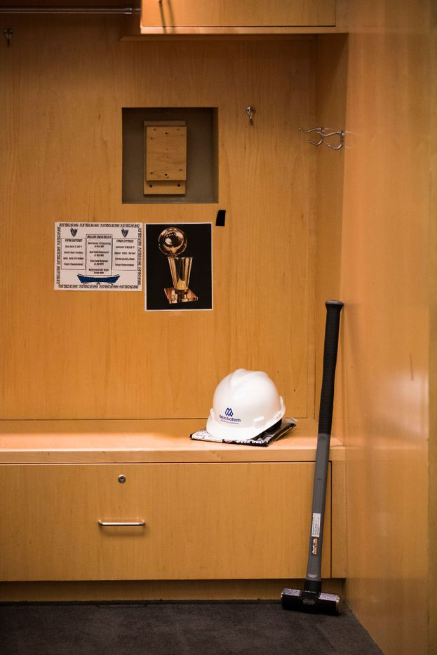 A sledgehammer and hard hat stand ready before Dallas Mavericks owner Mark Cuban begins the demolition process of the Mavericks locker room in a press availability before the 2017 NBA Draft at American Airlines Center on Thursday, June 22, 2017, in Dallas. The team is renovating the locker room into a state-of-the-art facility for the start of next season. (Smiley N. Pool/The Dallas Morning News)