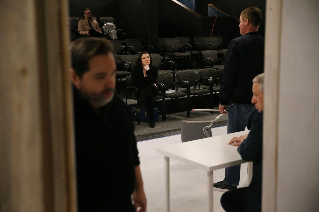Ashley H. White, co-founder and co-artistic director of Imprint Theatreworks, watches a scene during a rehearsal of  Glengarry Glen Ross at the Bath House Cultural Center in Dallas on Dec. 4, 2017.