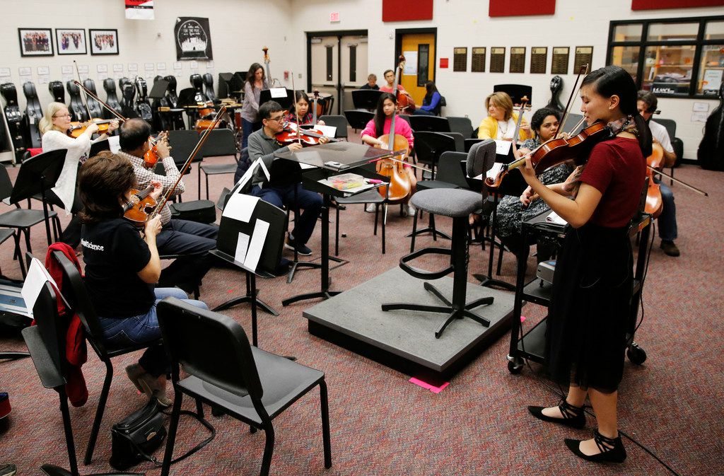 Assistant director of orchestra Victoria Lien leads a practice for parents of students at Liberty High School in Frisco on Nov. 7.