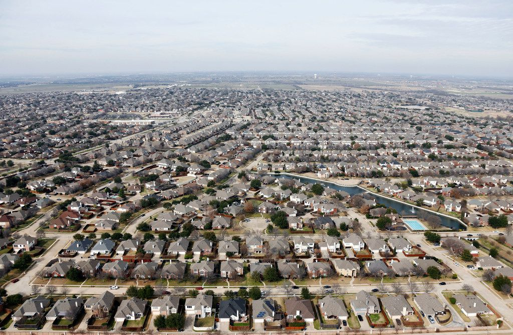 This aerial view of homes in Frisco was taken in February. Texas gained about 4.5 million residents between 2010 and 2020, thanks in large part to the growth of the native-born Latino population and migration from other states.