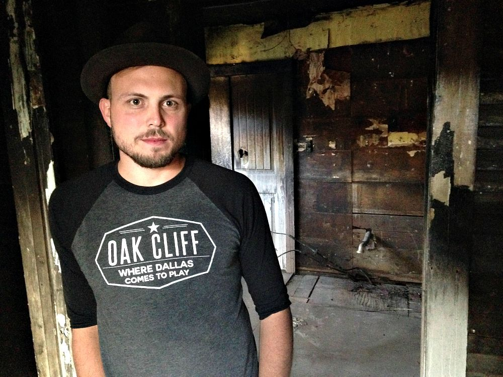 A.J. Ramler inside the home on Millard he hopes to renovate, now that the city attorney has (at least temporarily) spared it from the bulldozer