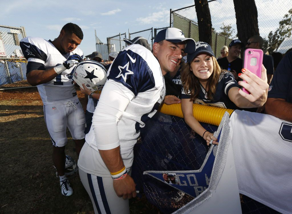 Jessica Nevarez, right, gets a selfie with kicker Dan Bailey (5), center, during the afternoon practice at Dallas Cowboys training camp in Oxnard, CA,  on July 27, 2014. (Michael Ainsworth/The Dallas Morning News)