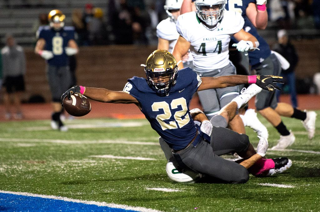 Jesuit senior running back EJ Smith (22) stretches for the goal line on a touchdown run in the first half of a high school football game against Prosper on Friday, October 11, 2019 at Postell Stadium in Dallas. (Jeffrey McWhorter/Special Contributor)