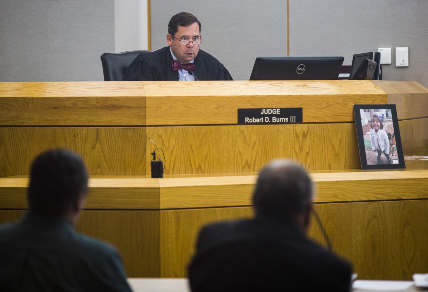 A photo of Leiliana Wright rests near Judge Robert D. Burns III during the final day of a trial for Charles Phifer (left) who was found guilty of capital murder in the March 2016 beating death the 4-year-old.