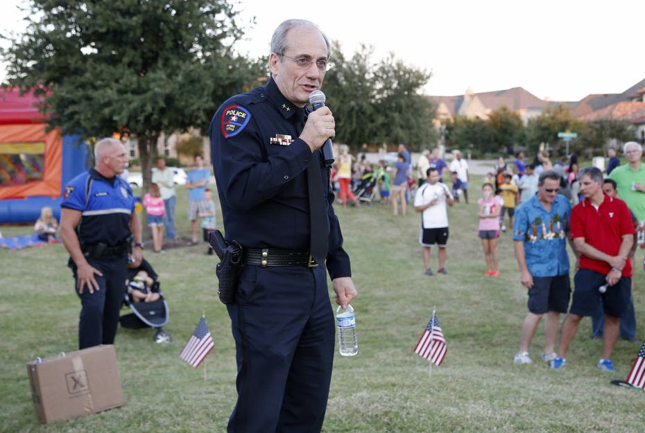 Plano Police Chief Greg Rushin discussed home safety issues at the National Night Out event in the Kings Ridge neighborhood in Plano in 2015.