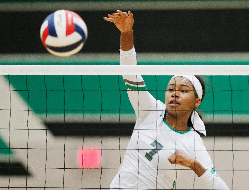 Southlake Carroll junior Asjia O'Neal spikes the ball during a match on September 20, 2016. Southlake won 3-0. (Brandon Wade/Special Contributor)