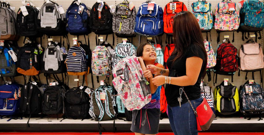 Back-to-School shoppers Tayde Salas, 9, pleads for her mother Cathy Salas to buy a pink backpack at Target as they get a head start on school supplies in Dallas, Wednesday, August 9, 2017. It's tax-free weekend in Texas starting Friday. (Tom Fox/The Dallas Morning News)