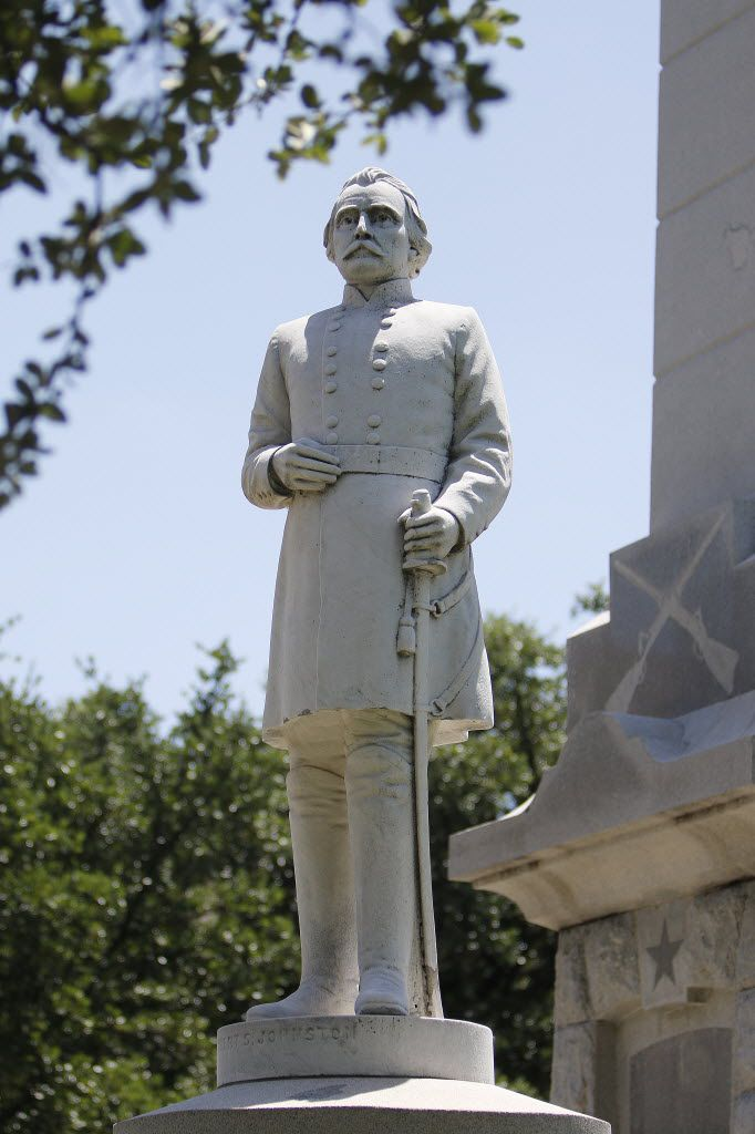 An Albert S. Johnston statue stands outside a Confederate memorial in Pioneer Park Cemetery in Dallas